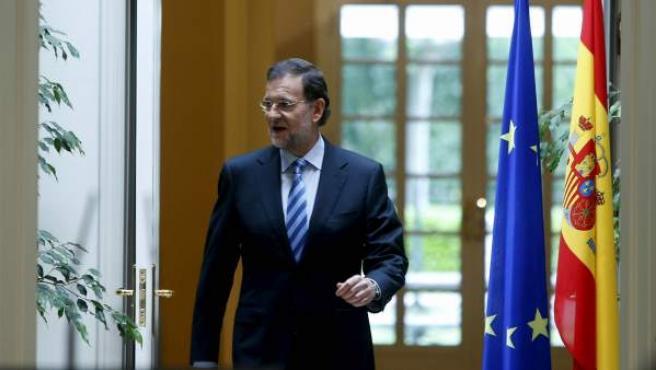 El presidente del Gobierno, Mariano Rajoy, antes de su primera comparecencia tras el rescate a la banca española.