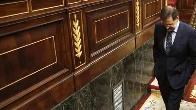 El presidente del Gobierno, Mariano Rajoy, a su salida del hemiciclo del Congreso de los Diputados, donde se ha celebrado el pleno en el que se han votado las últimas medidas de ajuste del Gobierno, incluidas la subida del IVA y la bajada en la prestación por desempleo. El Congreso ha convalidado con los votos a favor del PP, la abstención de UPN y el voto en contra del resto de grupos, el decreto de nuevos ajustes.
