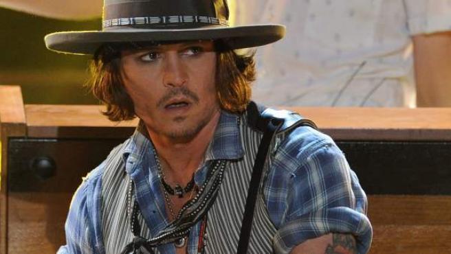 Johnny Depp, en directo en un concierto.