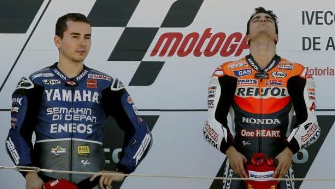 Jorge Lorenzo, segundo; y Dani Pedrosa, primero, en el podio.