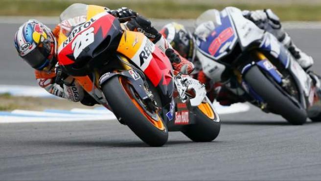 Dani Pedrosa y Jorge Lorenzo durante una carrera de MotoGP.