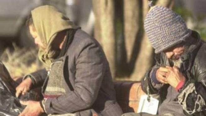Foto de archivo de dos mendigos.