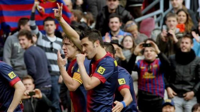 El delantero asturiano del Barça, David Villa, durante la celebración de un gol.