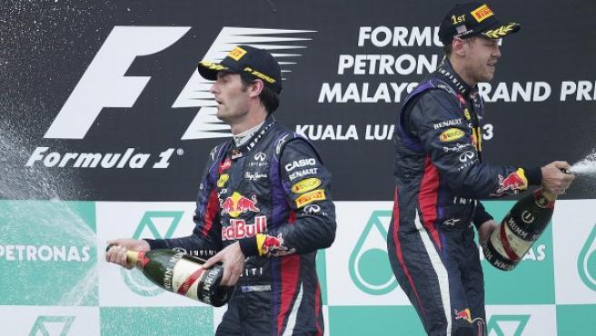 Webber y Vettel, en el podio de Malasia.