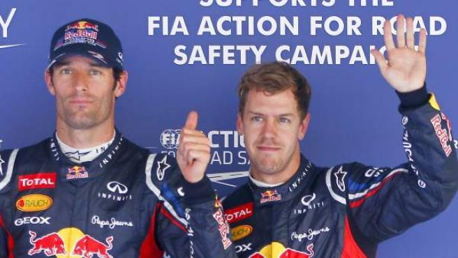 Los pilotos de Red Bull, Webber y Vettel, celebran ser los más rápidos en la clasificación de Corea.