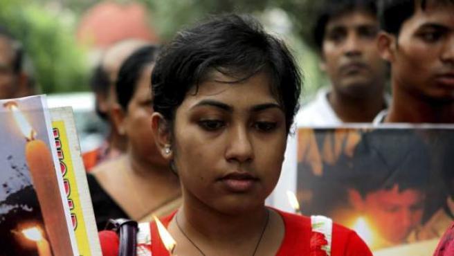 Varias activistas participan en una marcha de protesta contra un caso de violación en grupo ocurrido en la India.