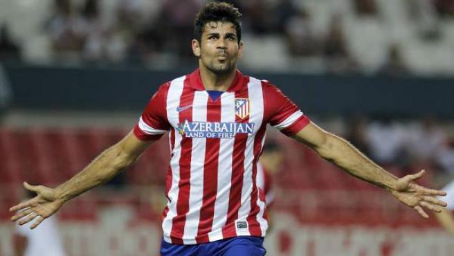 El delantero brasileño del Atlético de Madrid Diego Costa celebra uno de sus goles ante el Sevilla.