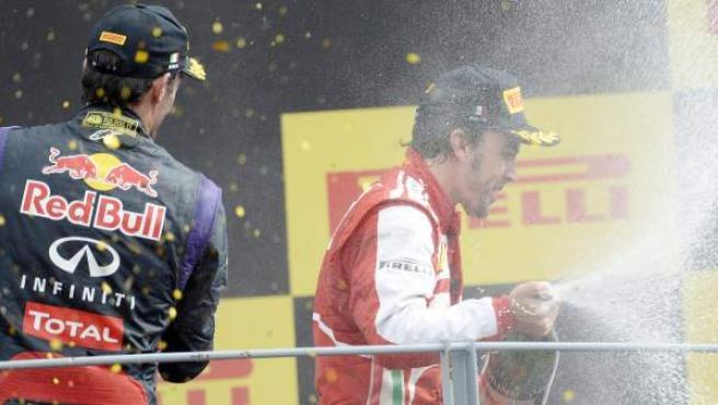 Alonso y Webber en el podio de Monza.