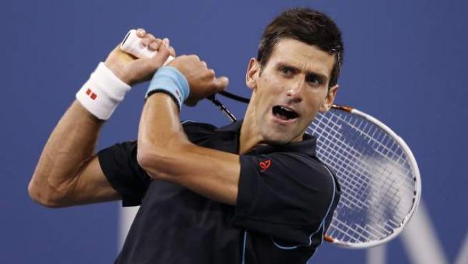 El tenista serbio Novak Djokovic, durante su partido frente a Mikhail Youzhny en cuartos de final del Abierto de Estados Unidos.