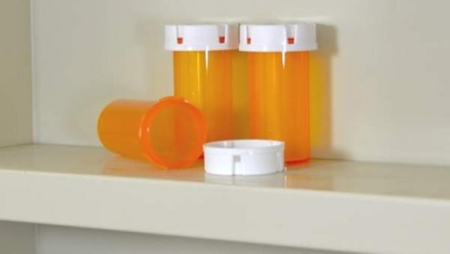 Botes de pastillas para aliviar el dolor.