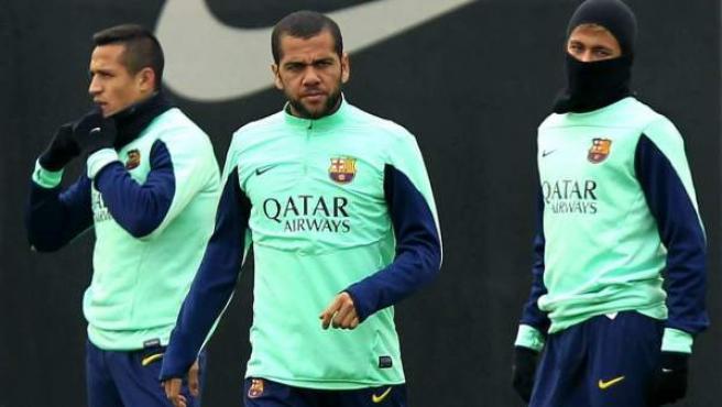 Alexis Sánchez, Dani Alves y Neymar, en un entrenamiento del Barcelona en la ciudad condal.