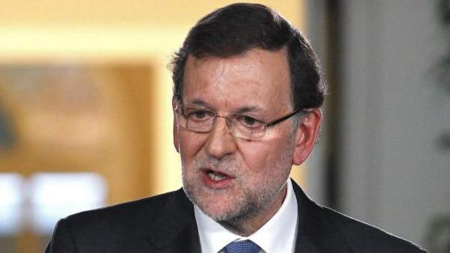 El presidente del Gobierno, Mariano Rajoy, durante la rueda de prensa que ofreció en Moncloa tras la última reunión del año del Consejo de Ministros en la que ha hecho un balance político y económico de 2013.