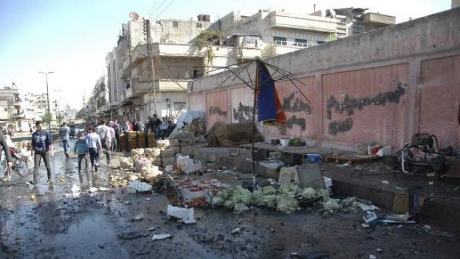 Imágenes del escenario de un atentado en la ciudad siria de Homs.