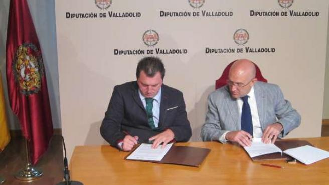 Los presidentes de Predif y la Diputación durante la firma del protocolo