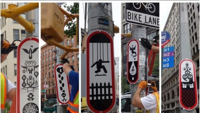 Operarios colocando algunas de las 'señales' urbanas de Ryan McGinness