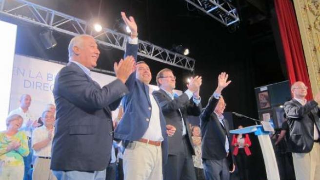 Arenas, Moreno y Rajoy, durante el acto del PP en Almería