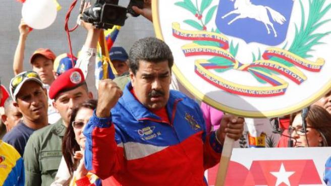 El mandatario de Venezuela, Nicolás Maduro (c), mientras participa en un evento en Caracas (Venezuela).