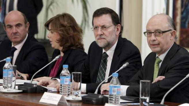De izquierda a derecha: Luis de Guindos, Soraya Sáenz de Santamaría, Mariano Rajoy y Cristóbal Montoro.