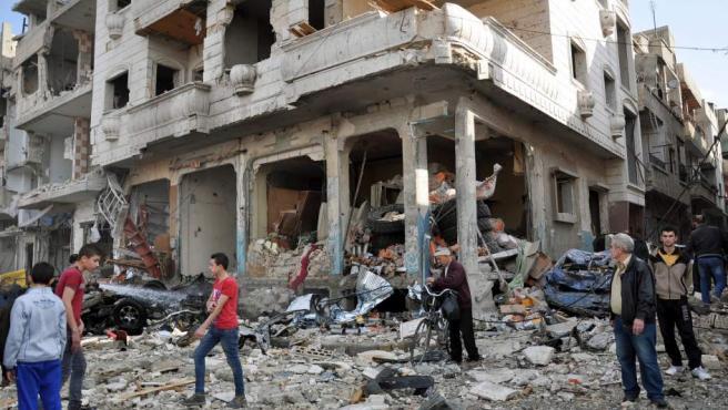 Imagen de la fachada de un edificio en la ciudad siria de Homs completamente destrozada por un atentado con coche bomba.