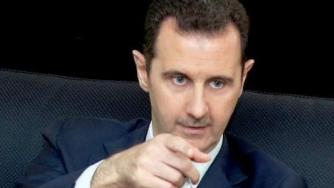 El presidente sirio, Bachar Al Asad, en una entrevista con la prensa.