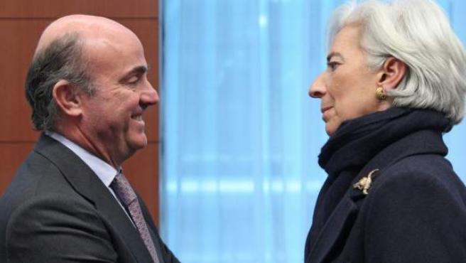 El ministro de Economía, Luis de Guindos, y la directora del FMI, Christine Lagarde.