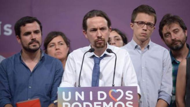 Alberto Garzón, Pablo Iglesias e Íñigo Errejón, en la rueda de prensa para valorar los resultados del 26-J.