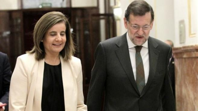Fátima Báñez y Mariano Rajoy, en una imagen de archivo.
