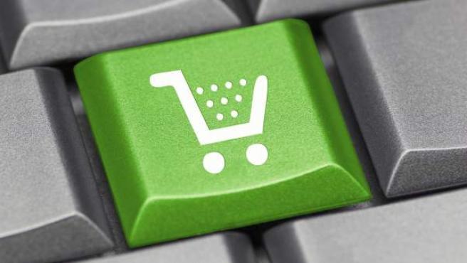 Un teclado con el dibujo de un carrito de la compra.