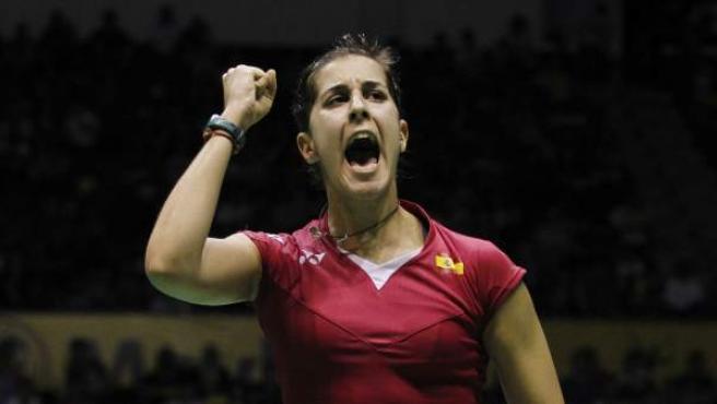 La española Carolina Marin celebra con su habitual garra un punto conseguido.