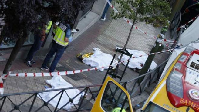 Los cadáveres de las tres personas halladas muertas en el despacho de abogados de Usera.
