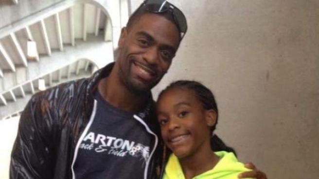 El velocista Tyson Gay, con su hija Trinity.