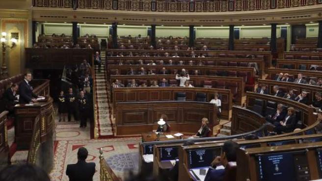 El presidente del Gobierno en funciones y candidato del PP, Mariano Rajoy, durante su intervención en la segunda jornada del debate de investidura, en el Congreso de los Diputados.