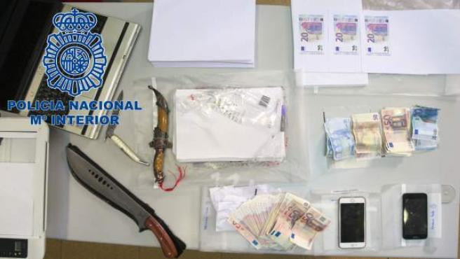 Operación policial contra un grupo de falsificación de moneda en Oviedo.