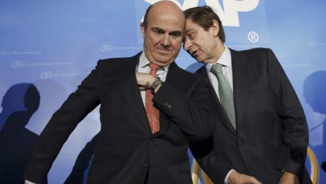 El ministro de Economía, Luis de Guindos (i) y el presidente de Bankia, José Ignacio Goirigolzarri.