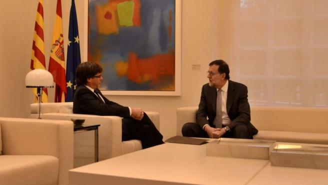 El presidente del Gobierno, Mariano Rajoy, y el de la Generalitat, Carles Puigdemont.