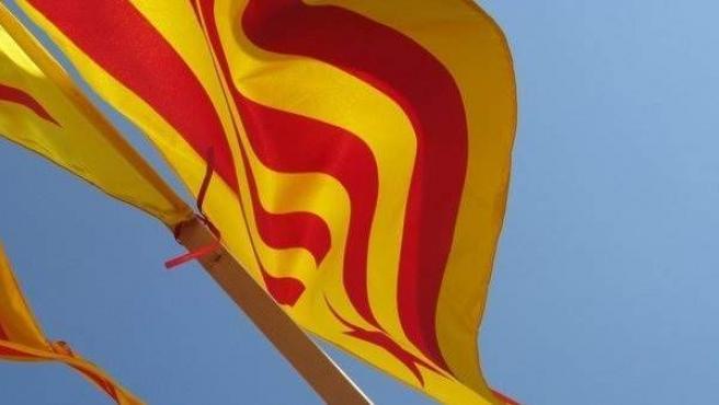 Imagen de una senyera, bandera catalana.