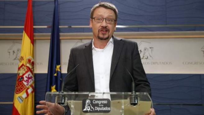 El portavoz de En Comù Podem, Xavier Domènech, en rueda de prensa en el Congreso.