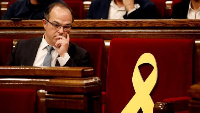 Jordi Turull, junto al escaño vacío de Jordi Sànchez, en una imagen de archivo.