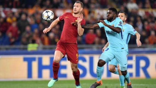 Edin Dzeko y Samuel Umtiti en el Roma - Barça.