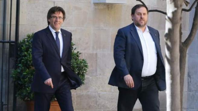 Carles Puigdemont y Oriol Junqueras, en la Generalitat, en una imagen de archivo.