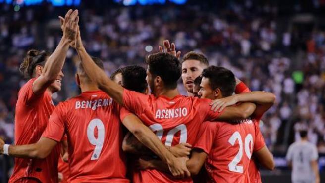 El Real Madrid con la camiseta color coral