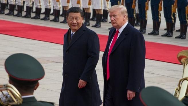 El presidente chino Xi Jinping y el presidente de EE UU Donald Trump en la visita de este último a China el año pasado.