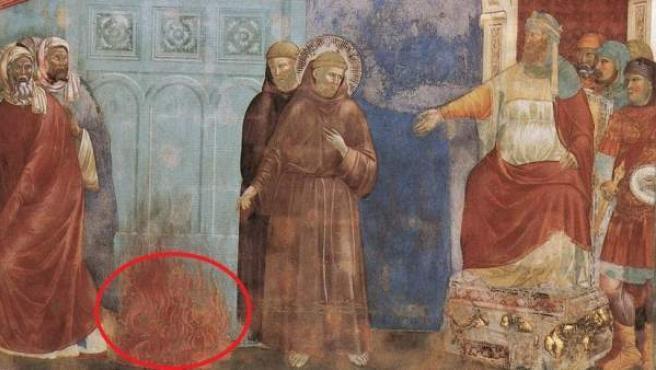 Rodeado de rojo, la representación del diablo pintada por Giotto en uno de sus frescos.