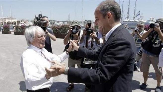 El expresidente valenciano Francisco Camps con el expresidente de la F1 Bernie Ecclestone.
