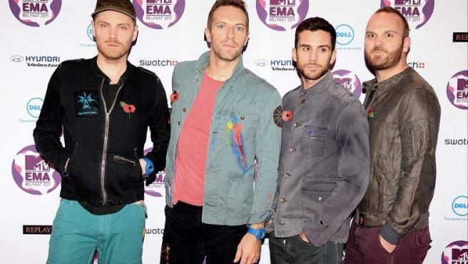 <p>Jonny Buckland, Chris Martin, Guy Berryman y Will Champion de la banda británica Coldplay llegan a los Premios MTV Europa 2011</p>