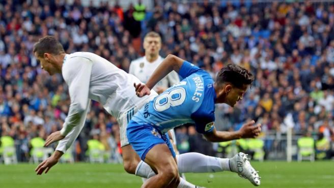 Un lance de un partido entre Real Madrid y Málaga