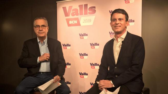 Celestino Corbacho, en un acto junto a Manuel Valls.