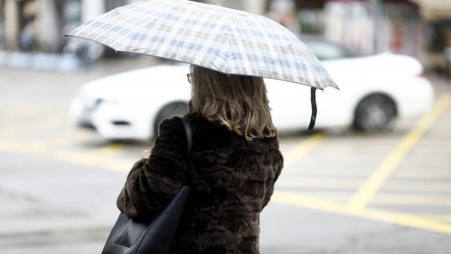 Frío, bajas temperaturas, abrigo, abrigarse, lluvia, llover, paraguas