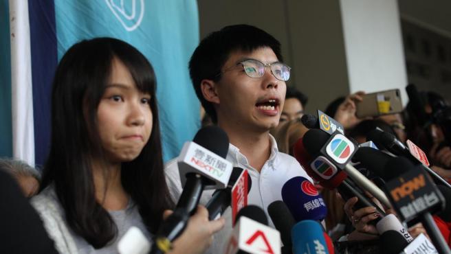Los líderes del partido hongkonés Demosisto, Agnes Chow y Joshua Wong.
