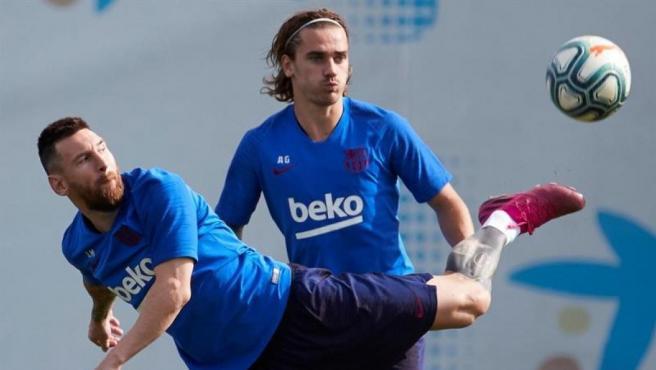 Messi y Griezmann, en un partido del Barça.